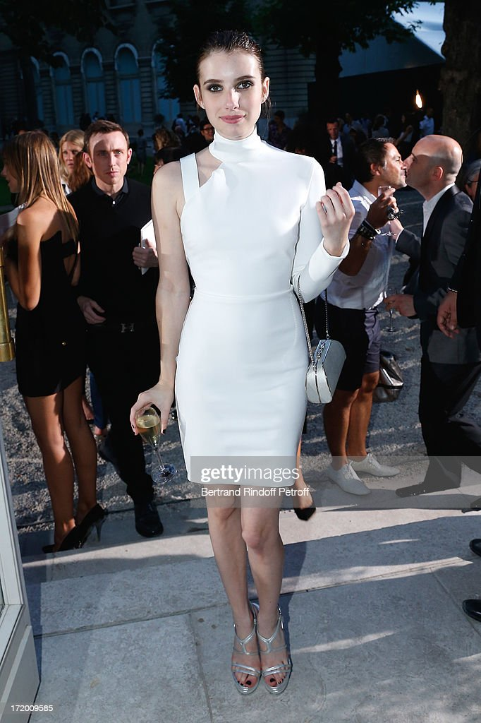 Actresse <a gi-track='captionPersonalityLinkClicked' href=/galleries/search?phrase=Emma+Roberts&family=editorial&specificpeople=226535 ng-click='$event.stopPropagation()'>Emma Roberts</a> attends the Versace show as part of Paris Fashion Week Haute-Couture Fall/Winter 2013-2014 at on June 30, 2013 in Paris, France.