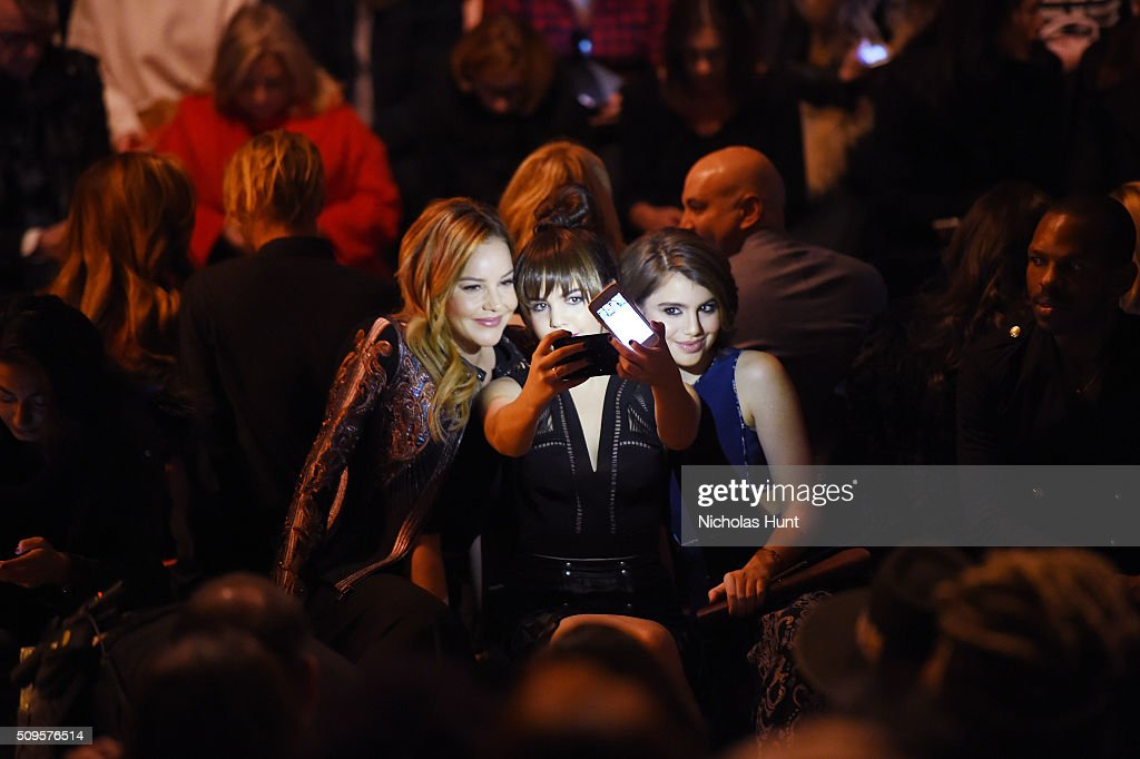 Actresses Abbie Cornish, Bailee Madison and Sami Gayle take a selfie as they attend the front row at the BCBGMAXAZRIA Fall 2016 show during New York Fashion Week at The Arc, Skylight at Moynihan Station on February 11, 2016 in New York City.