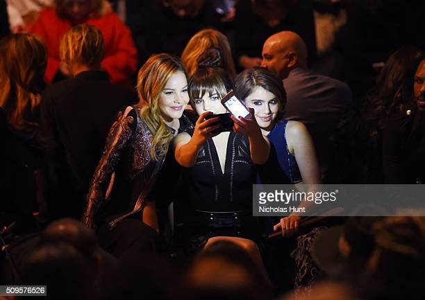 Actresses Abbie Cornish Bailee Madison and Sami Gayle take a selfie as they attend the front row at the BCBGMAXAZRIA Fall 2016 show during New York...