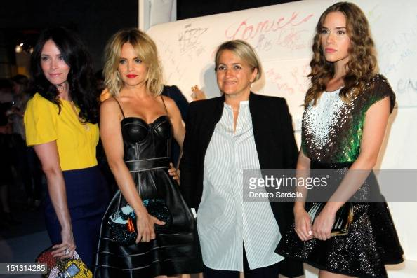 Actresses Abigail Spencer Mena Suvari and Christa B Allen wearing FENDI pose with FENDI Creative Director Silvia Fendi at FENDI Baguettemania...