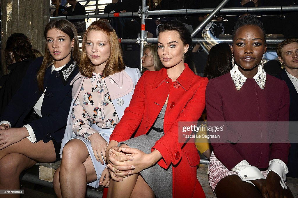 Actresses Adele Exarchopoulos, Lea Seydoux, <a gi-track='captionPersonalityLinkClicked' href=/galleries/search?phrase=Margot+Robbie&family=editorial&specificpeople=5781742 ng-click='$event.stopPropagation()'>Margot Robbie</a> and <a gi-track='captionPersonalityLinkClicked' href=/galleries/search?phrase=Lupita+Nyong%27o&family=editorial&specificpeople=10961876 ng-click='$event.stopPropagation()'>Lupita Nyong'o</a> attend the Miu Miu show as part of the Paris Fashion Week Womenswear Fall/Winter 2014-2015 on March 5, 2014 in Paris, France.