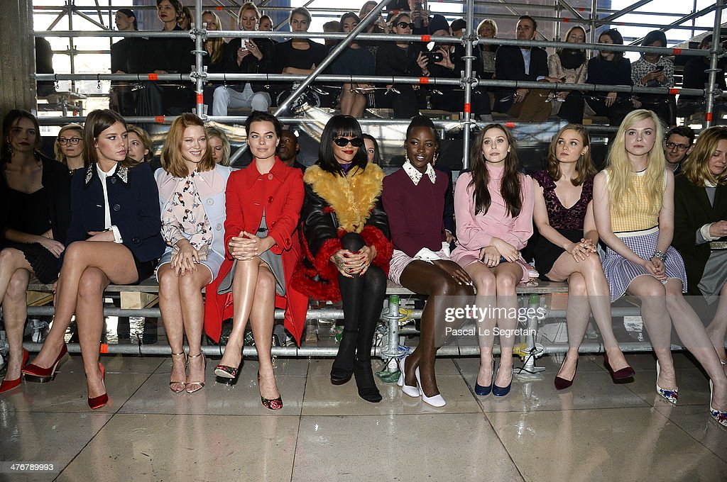 Actresses Adele Exarchopoulos, Lea Seydoux, Margot Robbie, singer Rihanna, actresses Lupita Nyong'o, Elizabeth Olsen, Bella Heathcote and Elle Fanning attend the Miu Miu show as part of the Paris Fashion Week Womenswear Fall/Winter 2014-2015 on March 5, 2014 in Paris, France.