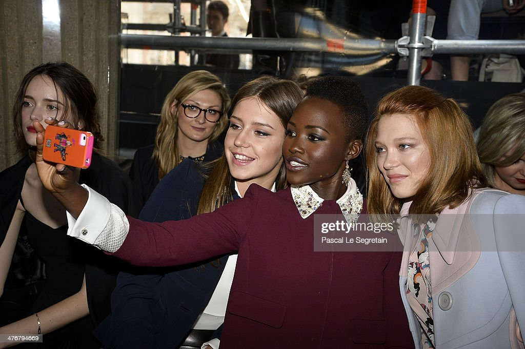 Actresses Adele Exarchopoulos, <a gi-track='captionPersonalityLinkClicked' href=/galleries/search?phrase=Lupita+Nyong%27o&family=editorial&specificpeople=10961876 ng-click='$event.stopPropagation()'>Lupita Nyong'o</a> and <a gi-track='captionPersonalityLinkClicked' href=/galleries/search?phrase=Lea+Seydoux&family=editorial&specificpeople=4398974 ng-click='$event.stopPropagation()'>Lea Seydoux</a> take a picture as they attend the Miu Miu show as part of the Paris Fashion Week Womenswear Fall/Winter 2014-2015 on March 5, 2014 in Paris, France.