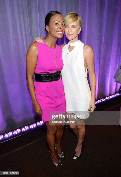 Actresses Aisha Tyler and Charlize Theron attend Variety's 5th Annual Power of Women event presented by Lifetime at the Beverly Wilshire Four Seasons...