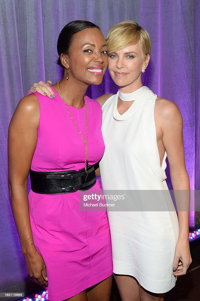 Actresses <a gi-track='captionPersonalityLinkClicked' href=/galleries/search?phrase=Aisha+Tyler&family=editorial&specificpeople=202262 ng-click='$event.stopPropagation()'>Aisha Tyler</a> (L) and <a gi-track='captionPersonalityLinkClicked' href=/galleries/search?phrase=Charlize+Theron&family=editorial&specificpeople=171250 ng-click='$event.stopPropagation()'>Charlize Theron</a> attend Variety's 5th Annual Power of Women event presented by Lifetime at the Beverly Wilshire Four Seasons Hotel on October 4, 2013 in Beverly Hills, California.