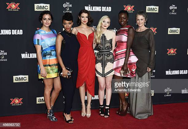 Actresses Alanna Masterson Sonequa MartinGreen Lauren Cohan Emily Kinney Danai Gurira and Melissa McBride arrive at the Season 5 premiere of AMC's...