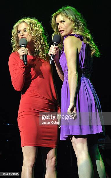 Actresses Alexis Carra and Brianna Brown perform onstage during the What A Pair Benefit Concert to support breast cancer research education programs...