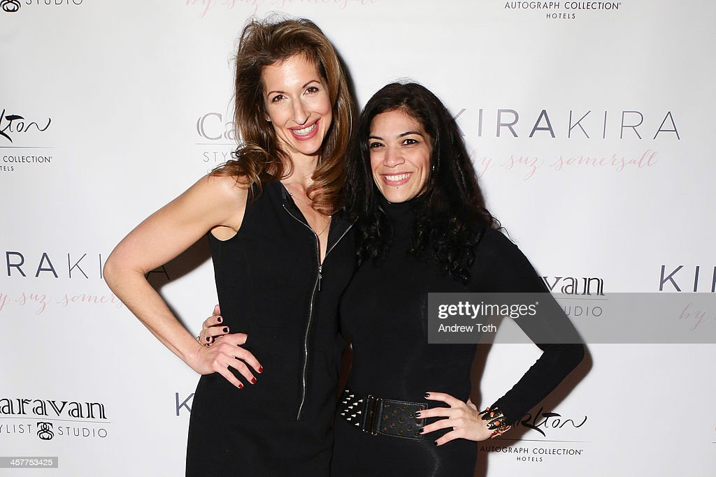 Actresses <a gi-track='captionPersonalityLinkClicked' href=/galleries/search?phrase=Alysia+Reiner&family=editorial&specificpeople=655685 ng-click='$event.stopPropagation()'>Alysia Reiner</a> (L) and Laura Gomez attend the 'Orange Is The New Black - My Year In Women's Prison' charity book shopping experience at Carlton Hotel on December 18, 2013 in New York City.
