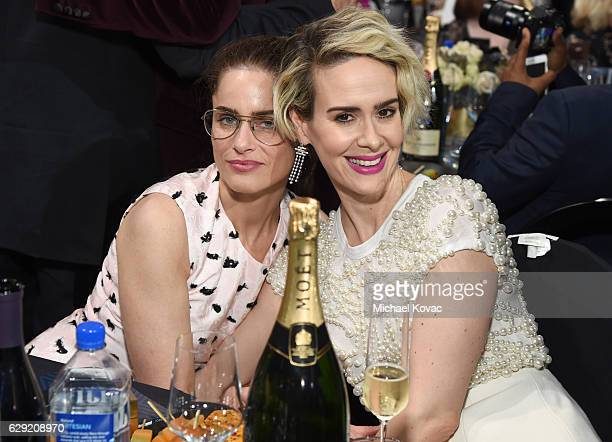 Actresses Amanda Peet and Sarah Paulson attend The 22nd Annual Critics' Choice Awards at Barker Hangar on December 11 2016 in Santa Monica California