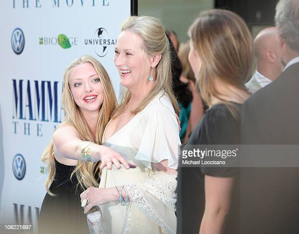 Actresses Amanda Seyfried and Meryl Streep with daughter Louisa Gummer attend the premiere of 'Mamma Mia' at the Ziegfeld Theatre on July 16 2008 in...