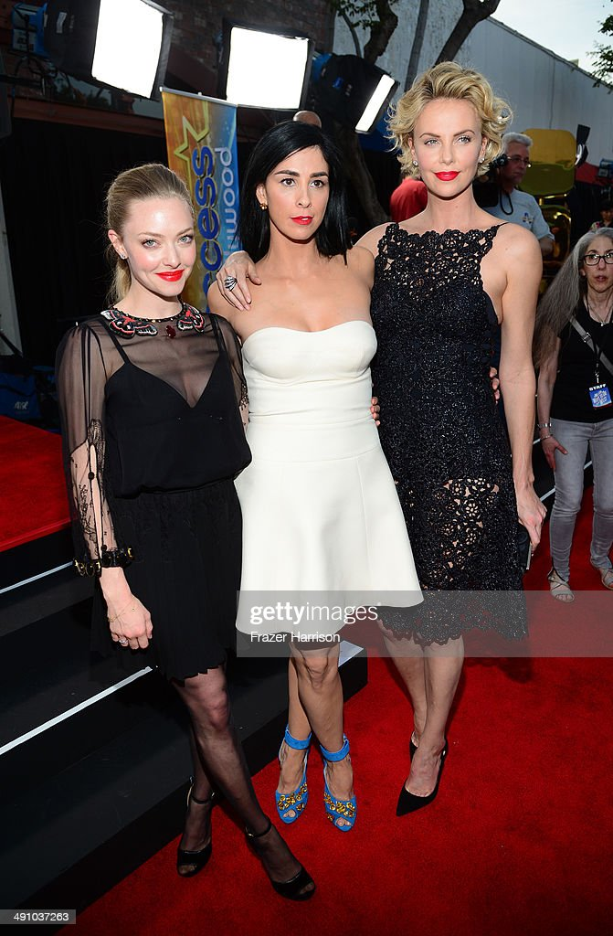 Actresses Amanda Seyfried, Sarah Silverman and Charlize Theron attend the premiere of Universal Pictures and MRC's 'A Million Ways To Die In The West' at Regency Village Theatre on May 15, 2014 in Westwood, California.