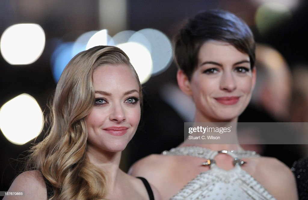 Actresses Amanda Seyfriend and Anne Hathaway attend the 'Les Miserables' World Premiere at the Odeon Leicester Square on December 5, 2012 in London, England.