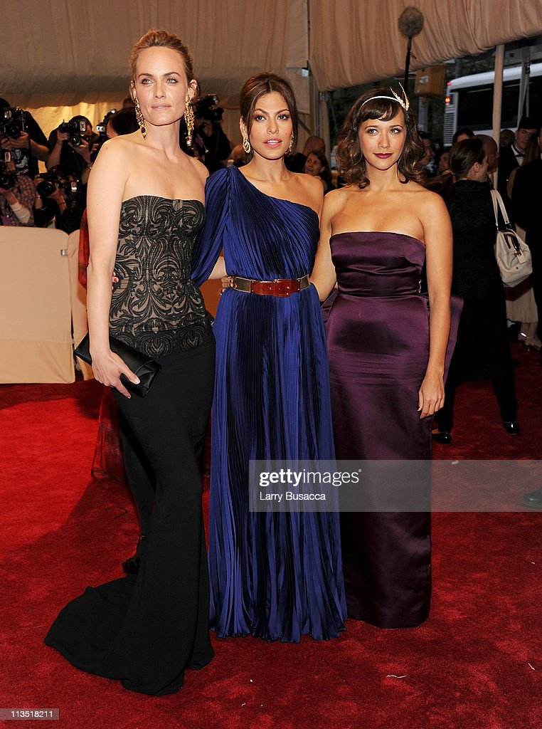 Actresses Amber Valletta, Eva Mendes and Rashida Jones attend the 'Alexander McQueen: Savage Beauty' Costume Institute Gala at The Metropolitan Museum of Art on May 2, 2011 in New York City.