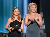 Actresses Amy Poehler and Amy Schumer present the Outstanding Supporting Actress in a Drama Series Award onstage during the 67th Annual Primetime...