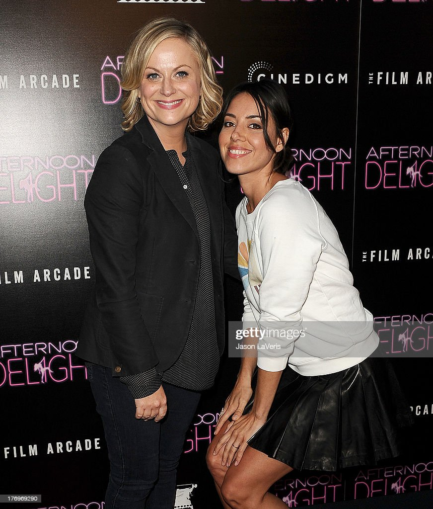 Actresses <a gi-track='captionPersonalityLinkClicked' href=/galleries/search?phrase=Amy+Poehler&family=editorial&specificpeople=228430 ng-click='$event.stopPropagation()'>Amy Poehler</a> and <a gi-track='captionPersonalityLinkClicked' href=/galleries/search?phrase=Aubrey+Plaza&family=editorial&specificpeople=5299268 ng-click='$event.stopPropagation()'>Aubrey Plaza</a> attend the premiere of 'Afternoon Delight' at ArcLight Hollywood on August 19, 2013 in Hollywood, California.