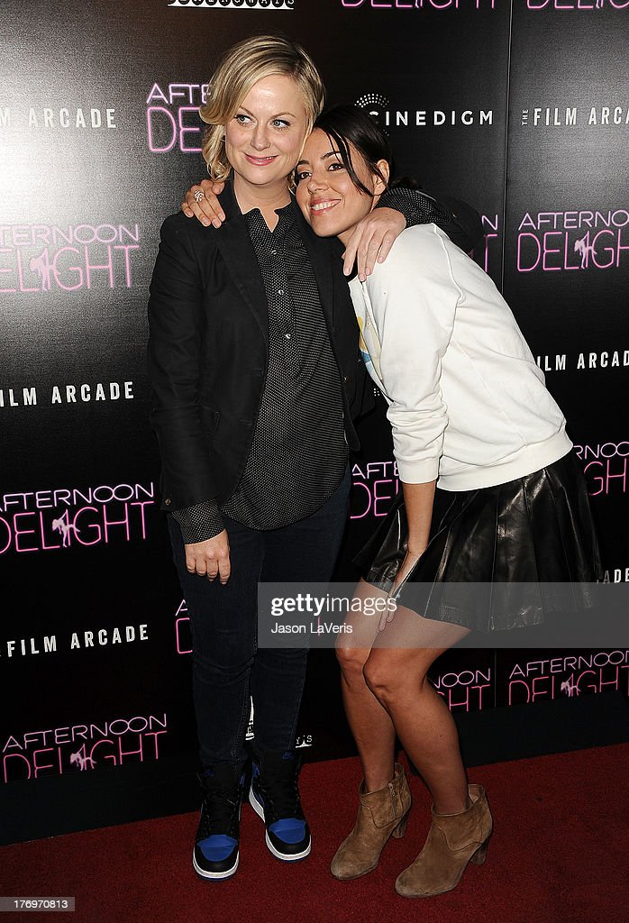 Actresses Amy Poehler and Aubrey Plaza attend the premiere of 'Afternoon Delight' at ArcLight Hollywood on August 19, 2013 in Hollywood, California.