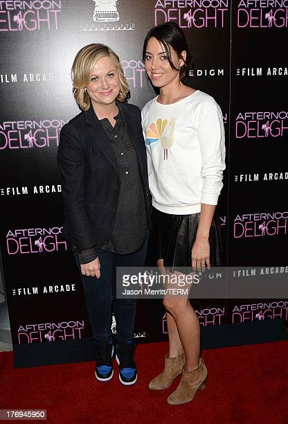 Actresses Amy Poehler and Aubrey Plaza attend the premiere of the Film Arcade and Cinedigm's 'Afternoon Delight' at ArcLight Hollywood on August 19...