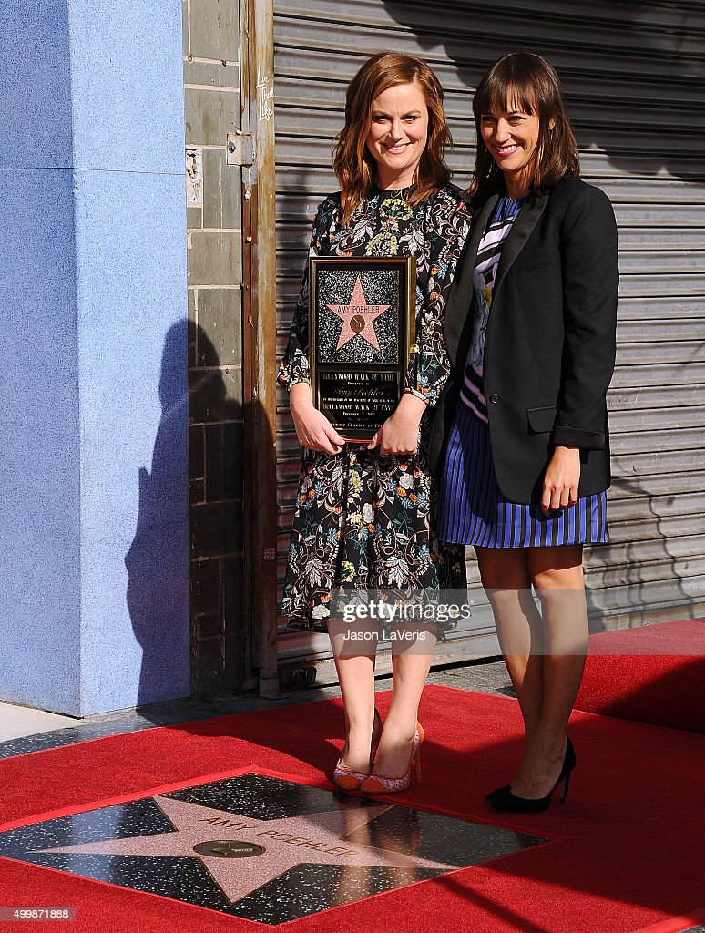 Actresses Amy Poehler and Rashida Jones attend Poehler's induction into the Hollywood Walk of Fame on December 3 2015 in Hollywood California