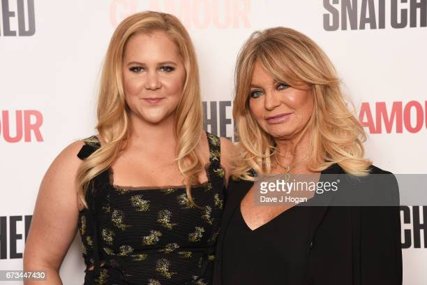 Actresses Amy Schumer and Goldie Hawn attend the screening of 'Snatched' at Soho Hotel on April 26 2017 in London United Kingdom