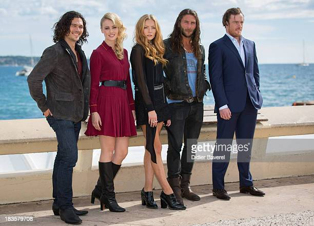 Actresses and actors Luke Arnold Hannah New Clara Paget Zach McGowan and Toby Stephens pose during the photocall of TV series 'Black Sails' at Mipcom...