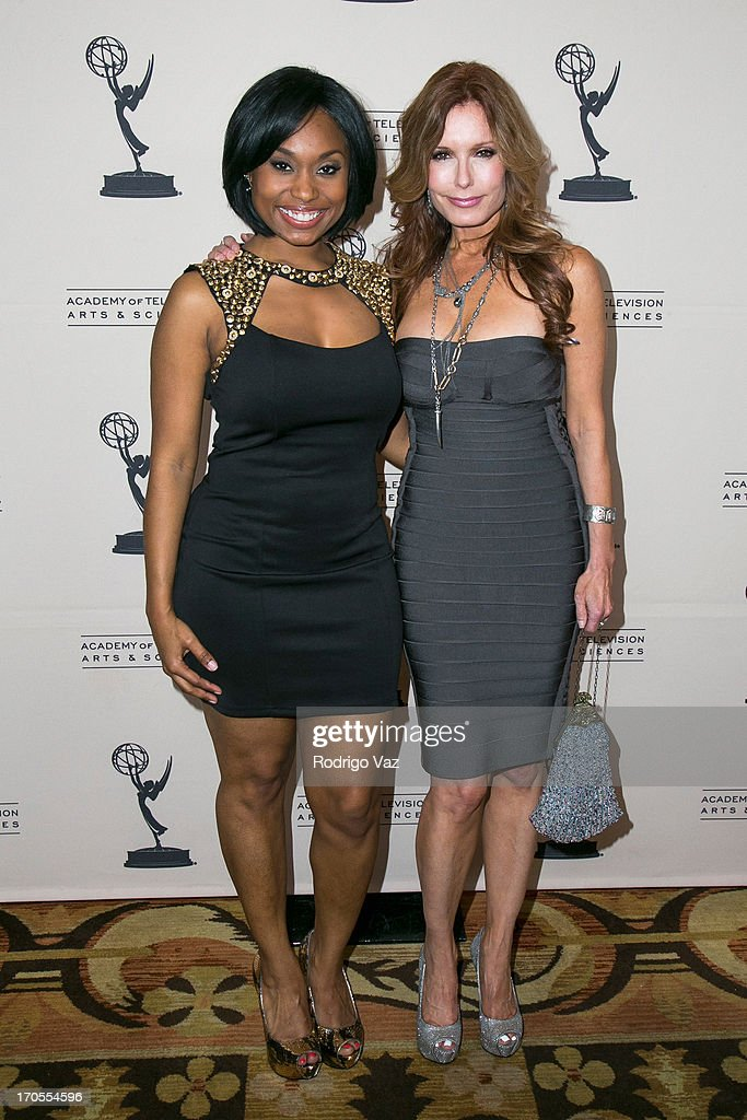 Actresses Angell Conwell (L) and Tracey E. Bregman arrive at the 40th Annual Daytime Emmy Nominees Cocktail Reception at Montage Beverly Hills on June 13, 2013 in Beverly Hills, California.