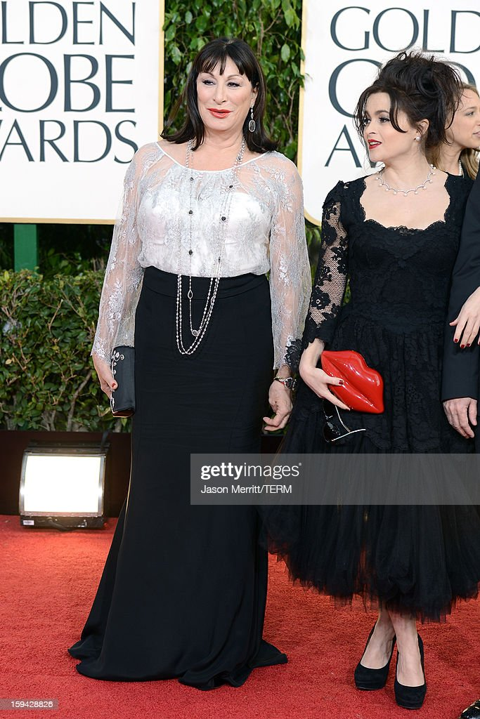 Actresses Anjelica Huston (L) and Helena Bonham Carter arrive at the 70th Annual Golden Globe Awards held at The Beverly Hilton Hotel on January 13, 2013 in Beverly Hills, California.