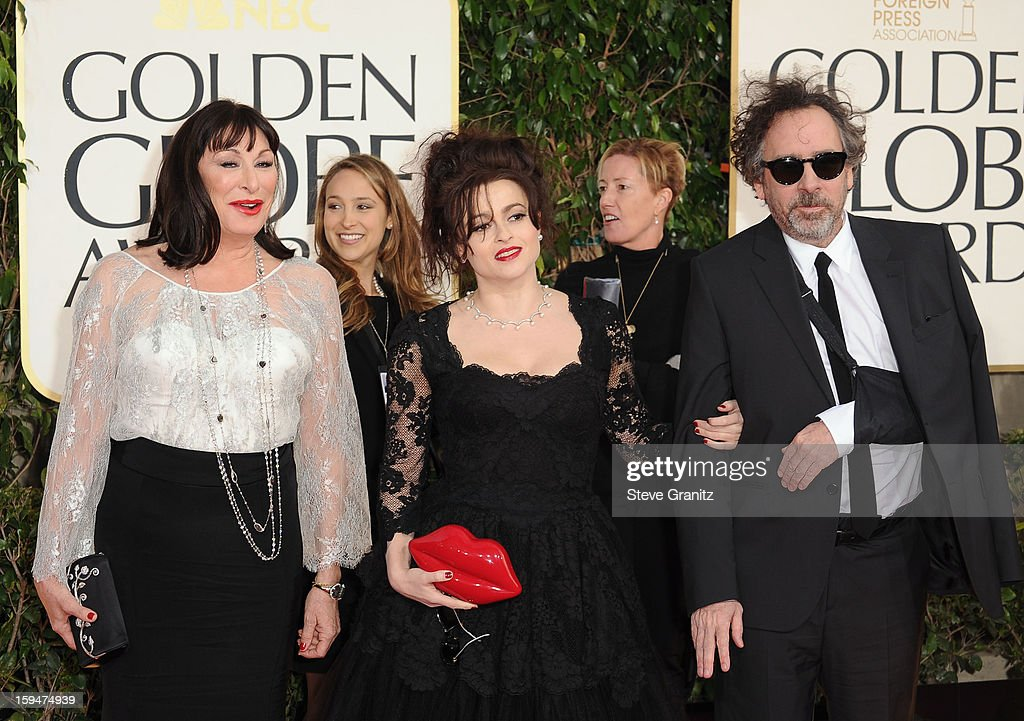 Actresses Anjelica Huston, Helena Bonham Carter and director Tim Burton arrive at the 70th Annual Golden Globe Awards held at The Beverly Hilton Hotel on January 13, 2013 in Beverly Hills, California.