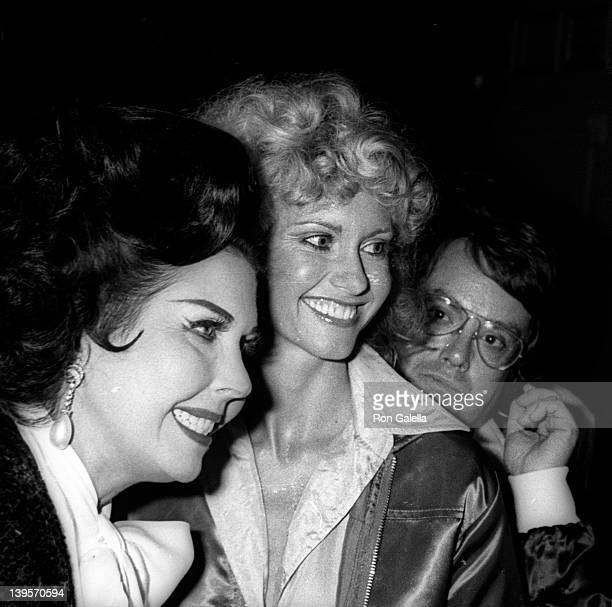 Actresses Ann Miller and Olivia NewtonJohn and producer Allan Carr attend the premiere party for 'Grease' on June 13 1978 at Sudio 54 in New York City