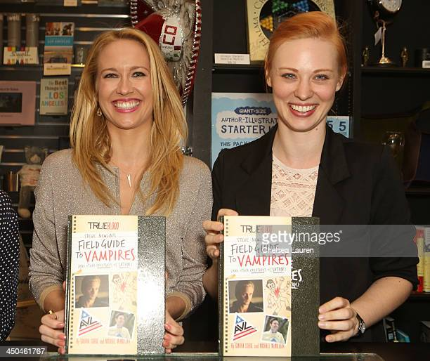 Actresses Anna Camp and Deborah Ann Woll attend the 'True Blood Steve Newlin's Field Guide to Vampires' book signing at Book Soup on November 18 2013...