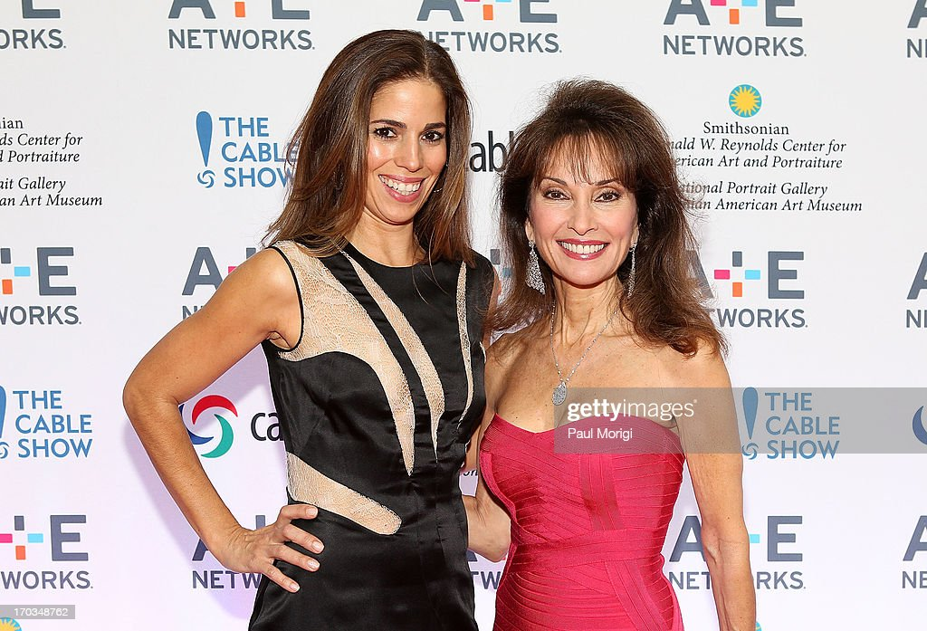 Actresses Anna Ortiz (L) and <a gi-track='captionPersonalityLinkClicked' href=/galleries/search?phrase=Susan+Lucci&family=editorial&specificpeople=203010 ng-click='$event.stopPropagation()'>Susan Lucci</a> of Devious Maids arrive at the A+E hosted NCTA Chairman's Reception at Smithsonian American Art Museum & National Portrait Gallery on June 11, 2013 in Washington, DC.