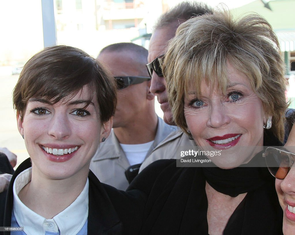 Actresses Anne Hathaway (L) and Jane Fonda attend the kick-off for One Billion Rising in West Hollywood on February 14, 2013 in West Hollywood, California.