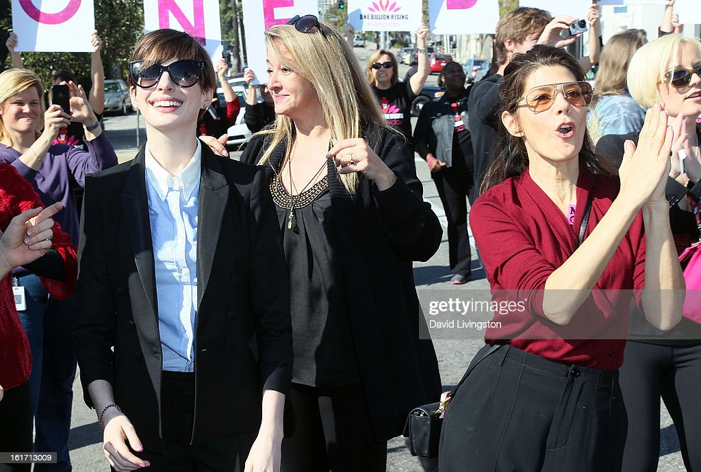 Actresses Anne Hathaway (L) and Marisa Tomei attend the kick-off for One Billion Rising in West Hollywood on February 14, 2013 in West Hollywood, California.