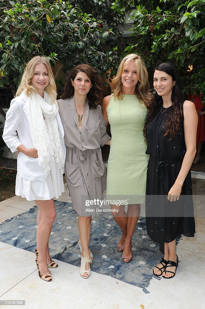 Actresses Apple Via, <a gi-track='captionPersonalityLinkClicked' href=/galleries/search?phrase=Marisa+Tomei&family=editorial&specificpeople=201516 ng-click='$event.stopPropagation()'>Marisa Tomei</a>, author Robyn O'Brien and actress Shiva Rose attend the 'Just Label It' (GMO labeling) campaign awareness seminar hosted by Shiva Rose on June 17, 2013 in Pacific Palisades, California.