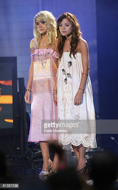 Actresses Ashley and MaryKate Olsen appears onstage at the 2004 MTV Video Music Awards at the American Airlines Arena August 29 2004 in Miami Florida