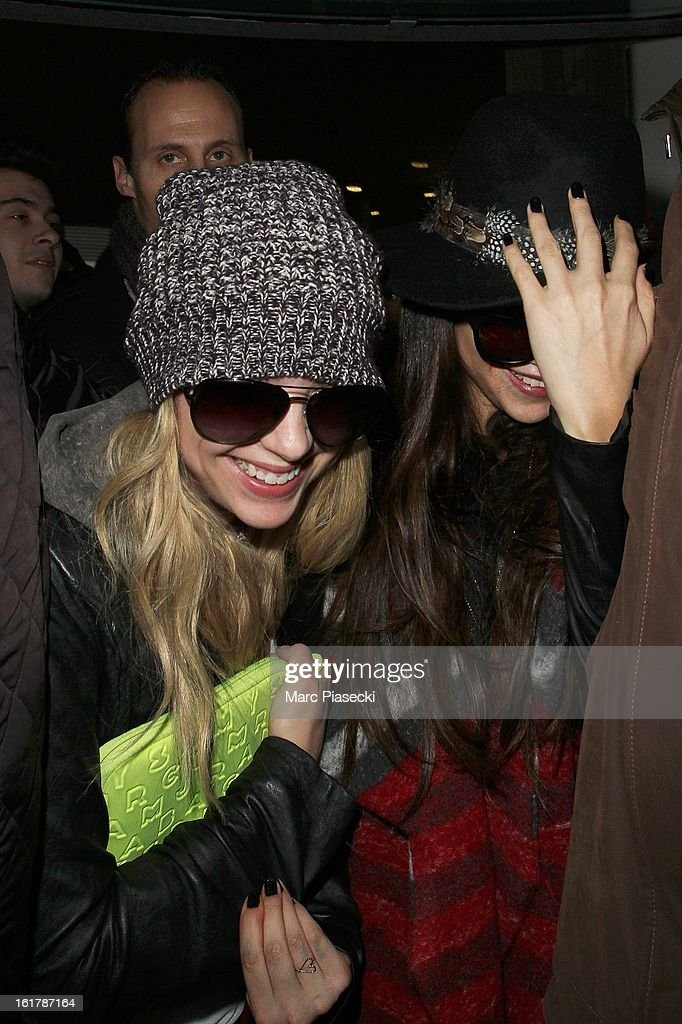 Actresses <a gi-track='captionPersonalityLinkClicked' href=/galleries/search?phrase=Ashley+Benson&family=editorial&specificpeople=594114 ng-click='$event.stopPropagation()'>Ashley Benson</a> and <a gi-track='captionPersonalityLinkClicked' href=/galleries/search?phrase=Selena+Gomez&family=editorial&specificpeople=4295969 ng-click='$event.stopPropagation()'>Selena Gomez</a> (R) arrive at Roissy airport on February 16, 2013 in Paris, France.
