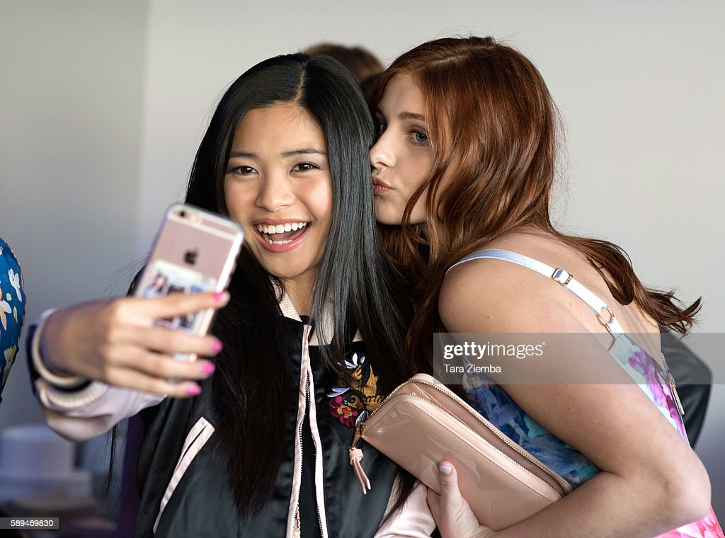 Actresses Ashley Liao and Jane Widdop take a selfie at Amazon and Tiger Beat Magazines premiere of 'The Kicks' at StubHub Center on August 13 2016 in...