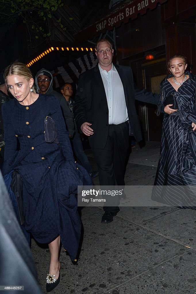 Actresses Ashley Olsen (L) and Mary-Kate Olsen leave the 'Charles James: Beyond Fashion' Costume Institute Gala after party at Up & Down on May 5, 2014 in New York City.