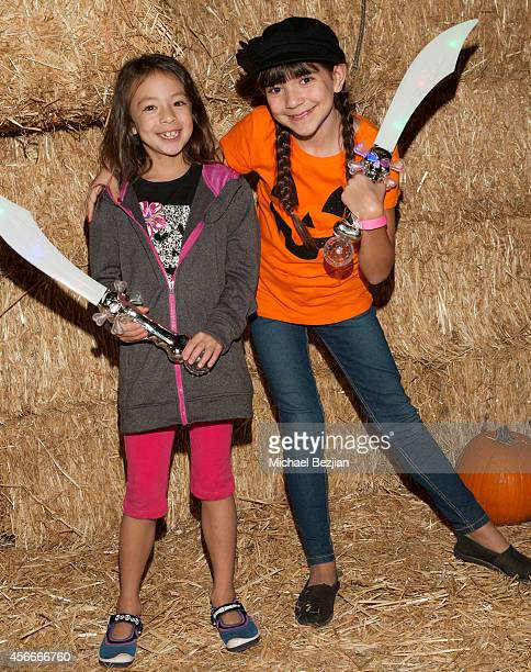 Actresses Aubrey AndersonEmmons and Chloe Noelle attend 'Rise Of The Jack O'Lanterns' Los Angeles Premiere at Descanso Gardens on October 4 2014 in...