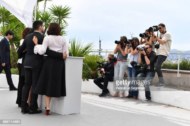 Actresses Aure Atika Hania Amar Nadia Kaci and director Karim Moussaoui attend 'Waiting For Swallows ' photocall during the 70th annual Cannes Film...