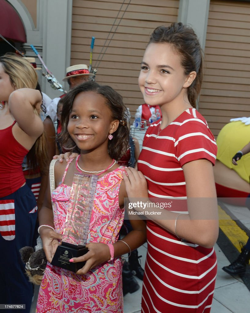 Actresses Bailee Madison Quvenzhane Wallis attend Variety's Power of Youth presented by Hasbro Inc and generationOn at Universal Studios Backlot on...