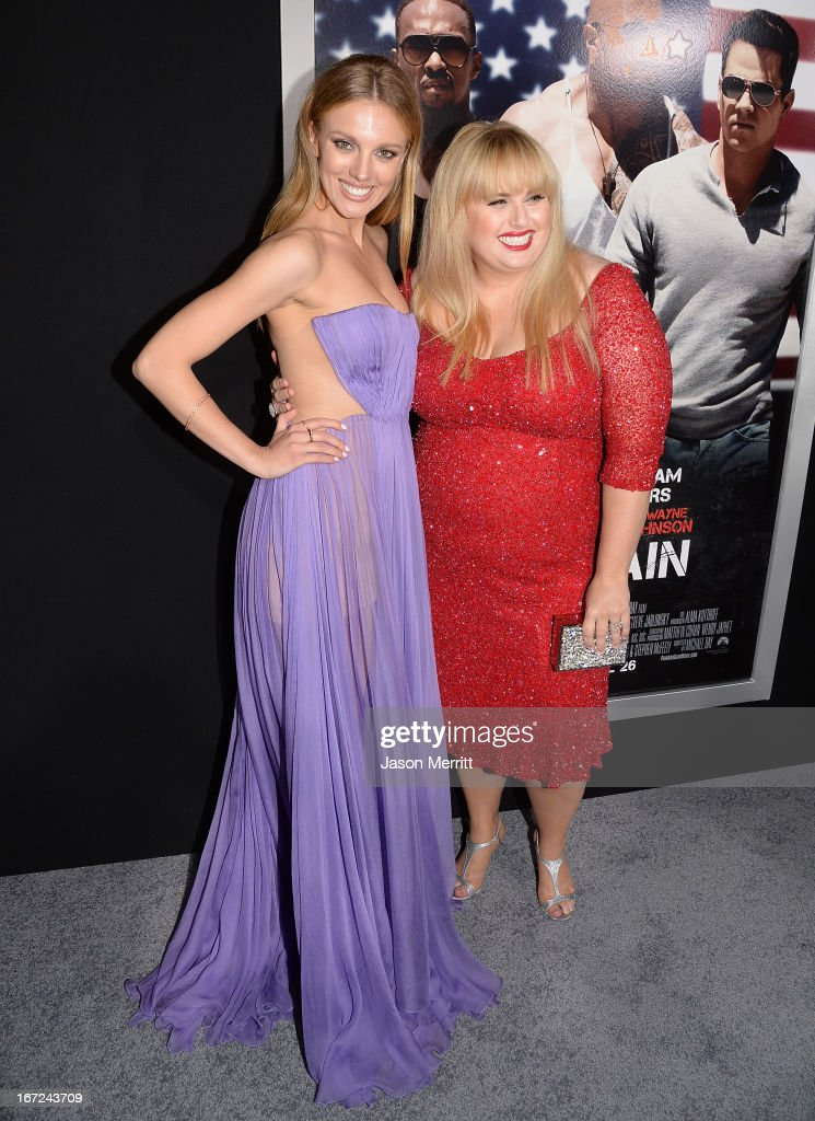 Actresses Bar Paly (L) and Rebel Wilson arrive at the premiere of Paramount Pictures' 'Pain & Gain' at TCL Chinese Theatre on April 22, 2013 in Hollywood, California.