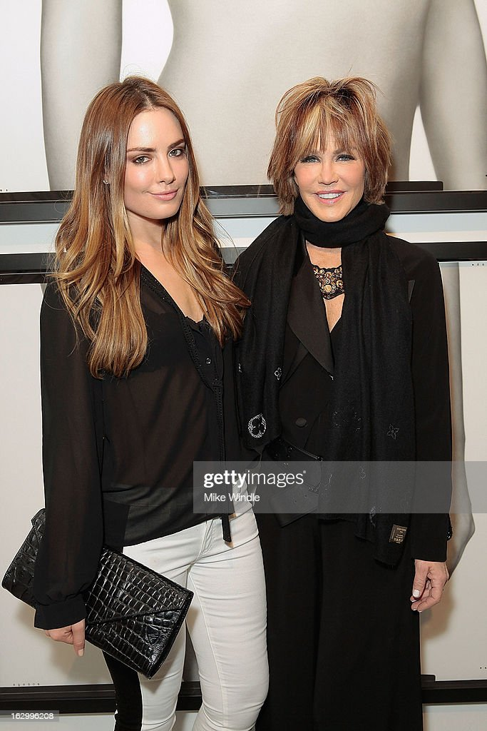 Actresses Beau Dunn and Laura Dunn attend the Samuel Bayer Ace Gallery Exhibit Opening, presented by Panavision at Ace Gallery on March 2, 2013 in Beverly Hills, California.