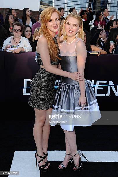 Actresses Bella Thorne and Claudia Lee arrive at the premiere of Summit Entertainment's 'Divergent' at the Regency Bruin Theatre on March 18 2014 in...