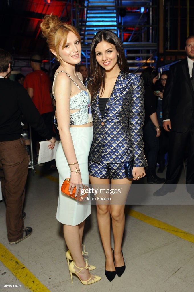 Actresses Bella Thorne and Victoria Justice attend Cartoon Network's fourth annual Hall of Game Awards at Barker Hangar on February 15 2014 in Santa...