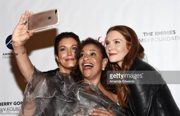 Actresses Bellamy Young Debbie Allen and Darby Stanchfield arrive at the Sunday Matinee Of 'Turn Me Loose' at the Wallis Annenberg Center for the...