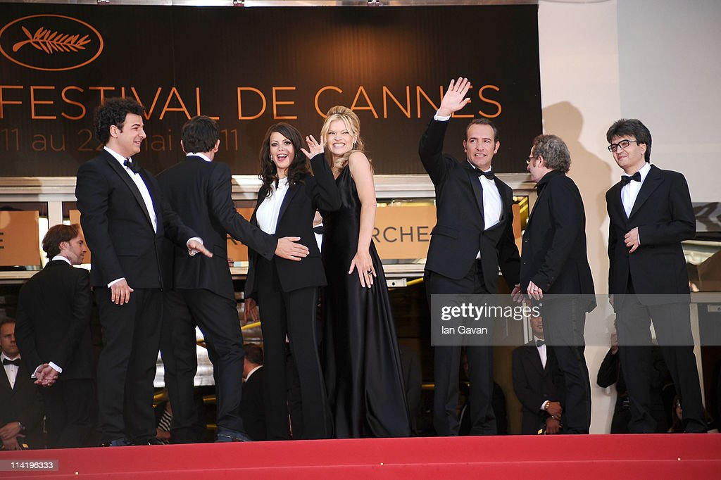 Actresses Berenice Bejo and Missi Pyle with actor Jean Dujardin attends 'The Artist' premiere at the Palais des Festivals during the 64th Annual Cannes Film Festival on May 15, 2011 in Cannes, France.
