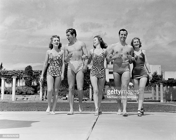 Actresses Betty Grable and Susan Hayward with friends walk in bathing suits in Los Angeles California