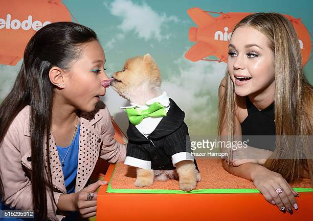 Actresses Breanna Yde and Brec Bassinger get kisses from Jiff at Nickelodeon's 2016 Kids' Choice Awards at The Forum on March 12 2016 in Inglewood...
