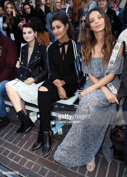 Actresses Brianna Hildebrand Janina Gavankar and Angela Sarafyan attend Rebecca Minkkoff's 'See Now Buy Now' fashion show at The Grove on February 4...