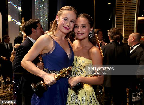 Actresses Brie Larsen and Alicia Vikander attend the 88th Annual Academy Awards at Dolby Theatre on February 28 2016 in Hollywood California